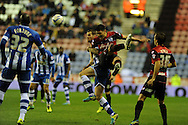 QPR's Alejandro Faurlin clashes with Wigan's Chris McCann.  Skybet championship match, Wigan Athletic  v Queens Park Rangers at the DW Stadium in Wigan, Lancs on Wed 30th Oct 2013. pic by Andrew Orchard, Andrew Orchard sports photography,