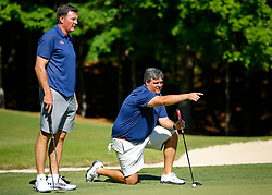 Ole Miss head football coach Matt Luke lines up a putt with Former Ole Miss tight end Wesley Walls during the Chick-fil-A Peach Bowl Challenge at the Ritz Carlton Reynolds, Lake Oconee, on Monday, April 30, 2019, in Greensboro, GA. (Paul Abell via Abell Images for Chick-fil-A Peach Bowl Challenge)