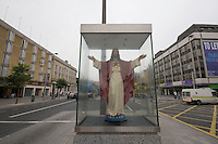Sacred Heart catholic statue in the middle of O'Connell Street in Dublin Ireland