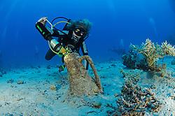 amphora, scuba diver at  unknown Roman ship wreck, South Egypt, Red Sea, MR