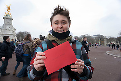 "© licensed to London News Pictures. London, UK 12/02/2012. Gay rights campaigner and Prime London's manager Martine Whitaker posing with her a Valentine's Day card to Buckingham Palace calling on the Queen to help ""kiss goodbye to homophobia"" in some Commonwealth countries. Photo credit: Tolga Akmen/LNP"