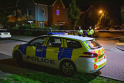 © Licensed to London News Pictures. 15/08/2021. Slough, UK. A police vehicle parked in front of two police officers guarding the scene following a double stabbing in Cippenham, Slough. Emergency services were called at approximately 17:00BST on Sunday 15/08/2021 to the Eltham Avenue area of Slough to reports that two male teenagers had been assaulted during an altercation between a number of youths. Both were taken to hospital with stab wounds. Photo credit: Peter Manning/LNP