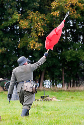 Re-enactors portraing German Panzer Grenadiers prepare for a Battle reenactment on Day one at the Showground Pickering<br /> 14 October 2012<br /> Image © Paul David Drabble