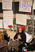 02 APRIL 2021 - MINNEAPOLIS, MINNESOTA: GRACE BUSSE, from the Twin Cities, chants while chained to the perimeter fence around the Hennepin County Courthouse. She is one of the protesters at the courthouse. Protesters are keeping a 24 hour presence in front of the Hennepin County Courthouse in Minneapolis during the murder trial of former Minneapolis Police Officer Derek Chauvin. Chauvin is on trial for murdering George Floyd in 2020. Floyd's death, while restrained and in police custody, set off a summer of racial justice protests across the United States.      PHOTO BY JACK KURTZ