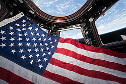 June 14, 2015 - Earth Atmosphere - On the International Space Station June 14, 2015 the crew of Expedition 44 prepare to observe Flag Day in the USA in the Cupola, the 360 degree observation point. (Credit Image: ? Scott Kelly/NASA via ZUMA Wire/ZUMAPRESS.com)