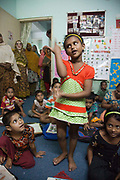 Dhaka, Bangladesh. Children and mothers at an Inclusive Pre-School where children both disabled and not are prepared for going to school in the Adabor/Mohammadpur area. The project is supported by Save the Children International. Centre for Services and Information on Disability (CSID) is a charity working for integrating disabled children into mainstream society.