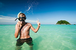 teenage boy with snorkeling equipment showing victory-sign, Koh Lipe, Thailand