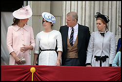 The Duchess of Cambridge feels her bump as she joins Royal Family to watch the fly past by the RAF, on Balcony at Buckingham Palace during Trooping The Colour, London, United Kingdom,<br /> Saturday, 15th June 2013<br /> Picture by Andrew Parsons / i-Images
