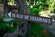 Hand carved wooden signs in beach-side hotel. Sanur, Bali, Indonesia.