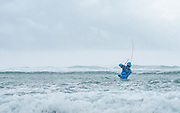 Seychelle guide Jerry Nourrice takes on a pounding surf and beyond marginal weather to chase triggers and marauding GTs...with both guns.