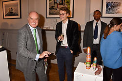 Nicholas Coleridge and his son Tommy Coleridge at Mark Shand's Adventures and His Cabinet Of Curiosities VIP private view, 32 Portland Place, London, England. 20 February 2018.