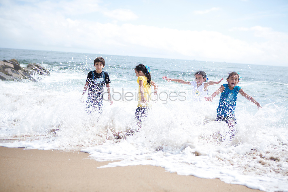Children Playing in Sea Water