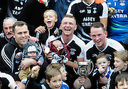 30-11-2014: Ardfert's Eamonn and his son Dylan O'Connor,  Shane Griffin with his son Shay and team captain captain Jerry Wallace celebrate their victory over Valley Rovers in the Munster GAA Club Intermediate Football final in Killarney on Saturday.<br /> Picture by Don MacMonagle XXJOB