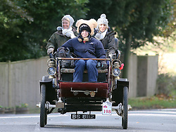 A 1903 Stevens-Duryea make's it's way through the village of Staplefield, in West Sussex, during the London to Brighton Veteran Car Run, Sunday, 3rd November 2013. Picture by Stephen Lock / i-Images