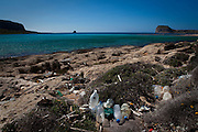 Plastic bottles, washed up on Balos Beach, on Gramvousa peninsula, in north western Crete, Greece. The beach is famous for its white sands and turquoise waters and is a protected nature reserve. More than 10% of plastic disgarded every year ends up in the ocean. These bottles can take up to 500 years to disintegrate. Just 15% of the plastic in the Mediterranean washes up on the beach.
