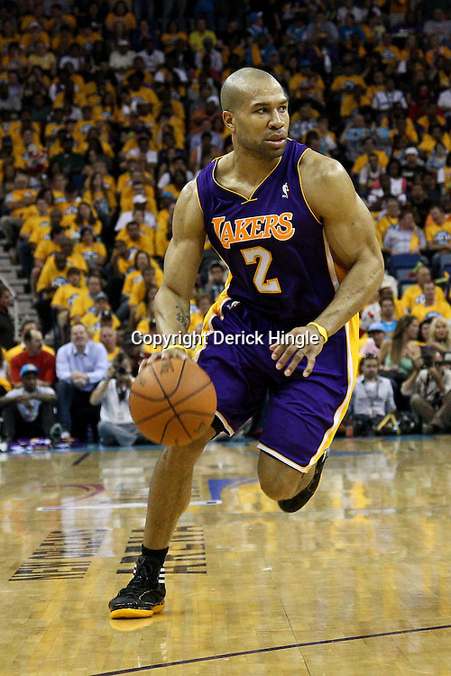 April 22, 2011; New Orleans, LA, USA; Los Angeles Lakers point guard Derek Fisher (2) against the New Orleans Hornets during the second half in game three of the first round of the 2011 NBA playoffs at the New Orleans Arena. The Lakers defeated the Hornets 100-86.   Mandatory Credit: Derick E. Hingle