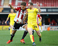 Brentford defender Harlee Dean and Rotherham United midfielder Aidan White tussle for the ball during the Sky Bet Championship match between Brentford and Rotherham United at Griffin Park, London, England on 17 October 2015. Photo by Andy Walter.