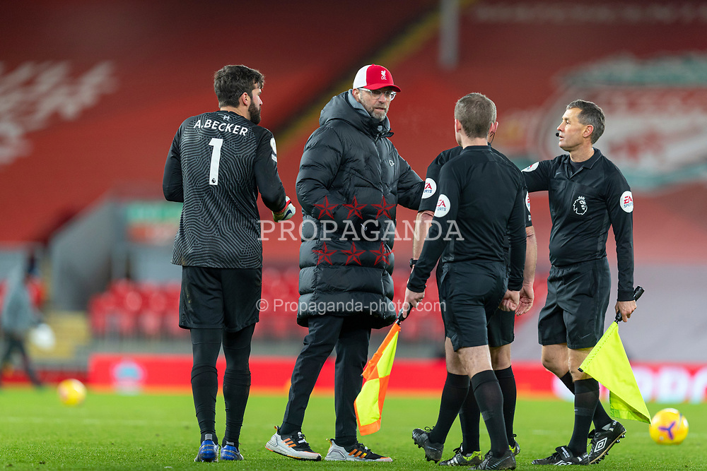 LIVERPOOL, ENGLAND - Thursday, January 21, 2021: Liverpool's goalkeeper Alisson Becker and manager Jürgen Klopp with the referees after the FA Premier League match between Liverpool FC and Burnley FC at Anfield. Burnley won 1-0 ending Liverpool's run of 68 games unbeaten at home. (Pic by David Rawcliffe/Propaganda)