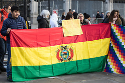 London, UK. 30 November, 2019. Activists from Bolivia Solidarity Campaign (BSC), joined by Plataforma 12 de Octubre (P12O) and other organisations, take part in an international protest in solidarity with the Plurinational State of Bolivia against the ousting by means of a military coup of Evo Morales, its first indigenous President, and the subsequent massacre of indigenous people protesting against the military takeover.