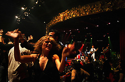 People are seen during a show at the Music Hall, Beirut, Lebanon, March 26, 2006.