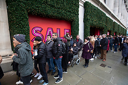 © Licensed to London News Pictures. 26/12/2019. Boxing Day bargain hunters brave the cold and the rain in Oxford Street for a chance to get large discounts on designer items. Photo credit : Alex Lentati/LNP