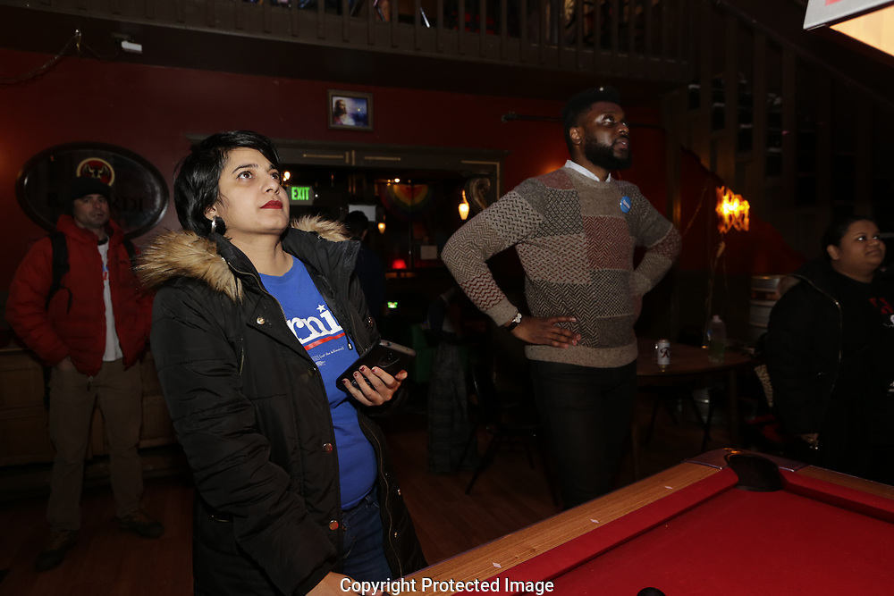 at an informal campaign party for Democratic presidential candidate Sen. Bernie Sanders, I-Vt. as the first results come in for the Washington State primary, Tuesday, March 10, 2020, in Seattle. (AP Photo/John Froschauer)