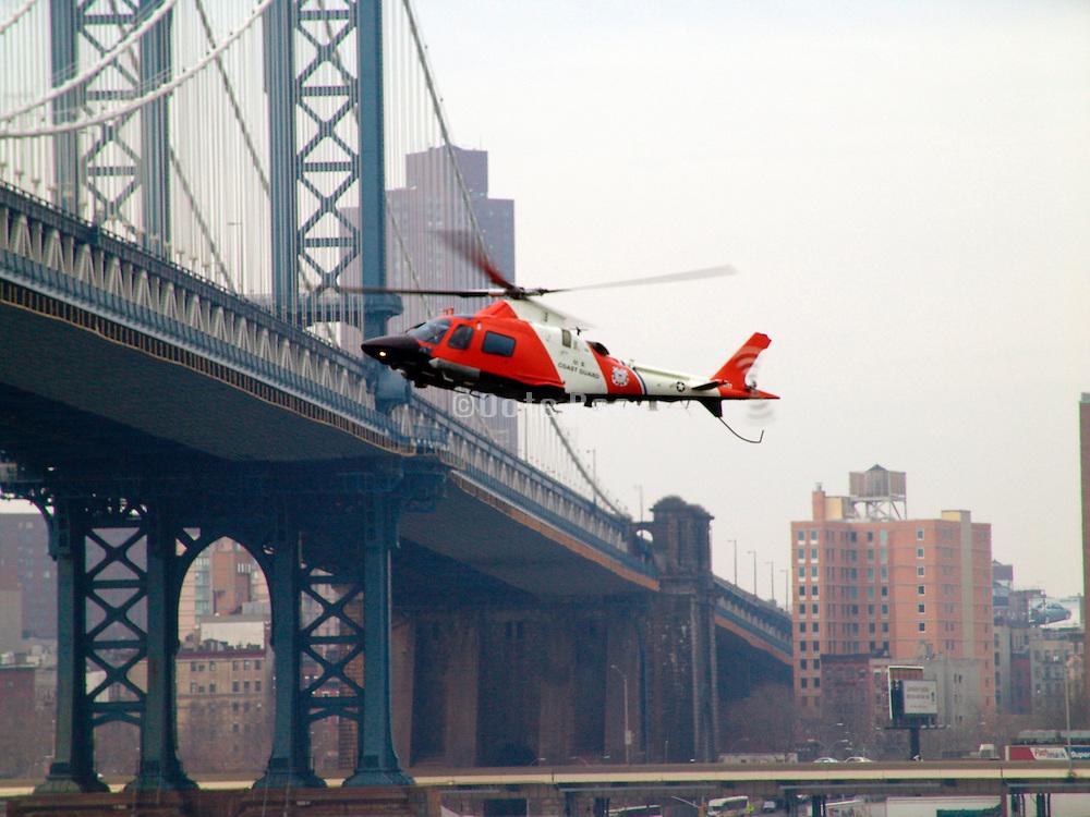 U.S. coast guard helicopter near the Manhattan bridge.