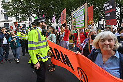 © Licensed to London News Pictures. 25/08/2021. London, UK. Protesters take part in EXTINCTION REBELLION'S THE IMPOSSIBLE REBELLION demonstration outside the Brazilian Embassy on a global day of action for Indigenous Peoples of the Amazon rainforest. Photo credit: Ray Tang/LNP