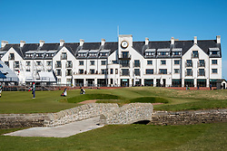 View of Carnoustie Golf Course Hotel behind 18th Green with Barry Burn and bridge  in foreground at Carnoustie Golf Links in Carnoustie, Angus, Scotland, UK. Carnoustie is venue for the 147th Open Championship in 2018.
