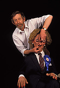 A portrait of the satirical puppet of Margaret Thatcher with Spitting with Spitting Image co-creator Peter Fluck and wears a blue Conservative rosette and For Hire sticker, on 20th March 1992, in London England. Peter Nigel Fluck is a caricaturist and one half of the partnership known as Fluck and Flaw with Roger Law, creators of the satirical TV puppet show Spitting Image.