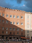 The Piazza del Campo has many bars and restaurants, and is busy with tourists and locals in Siena, Tuscany, Italy