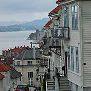 Three weeks aboard the Kong Harald. Hurtigruten, the Coastal Express. Bergen. Typical norwegian house in Bergen.