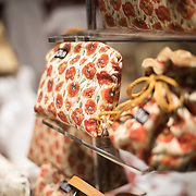 Woven bags on display in a shop window in the historic center of Bruges, Belgium. The region is historically famous for its textiles and lace.