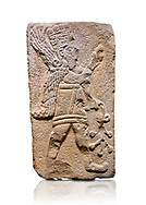 Aslantepe Hittite relief sculpted orthostat stone panel. Limestone, Aslantepe Malatya, 1200-700 B.C. Anatolian Civilisations Museum, Ankara, Turkey. Winged protective god holds a branch with fruits. in his left hand, and a fruit in his right hand.<br /> <br /> Against a white background. <br /> <br /> If you prefer to buy from our ALAMY STOCK LIBRARY page at https://www.alamy.com/portfolio/paul-williams-funkystock/hittite-art-antiquities.html . Type - Aslantepe - in LOWER SEARCH WITHIN GALLERY box. Refine search by adding background colour, place, museum etc.<br /> <br /> Visit our HITTITE PHOTO COLLECTIONS for more photos to download or buy as wall art prints https://funkystock.photoshelter.com/gallery-collection/The-Hittites-Art-Artefacts-Antiquities-Historic-Sites-Pictures-Images-of/C0000NUBSMhSc3Oo
