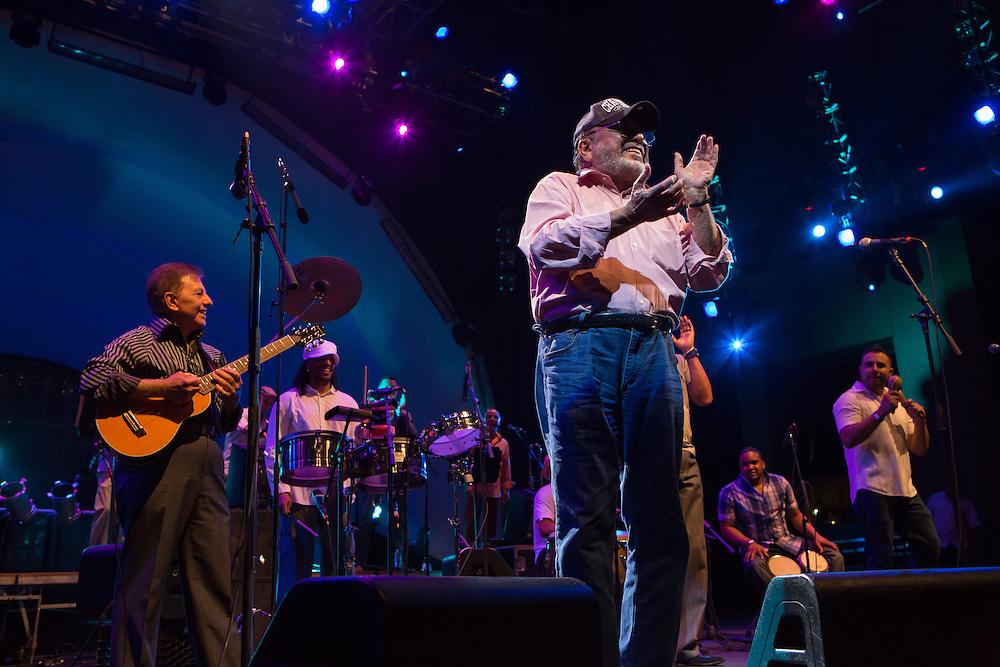 Bandleader Eddie Palmieri in a baseball cap on stage at Celebrate Brooklyn!