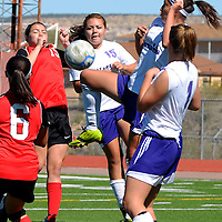 10/12/2013 - Photo: Jeff Jones<br /> Miyamura Lady Patriot  Riley Etcitty (7) uses her knee to keep the ball away from Grants Lady Pirate Randee Romero (15) at Public School Stadium in Gallup.  The Lady Patriots varsity girls won 1-0.