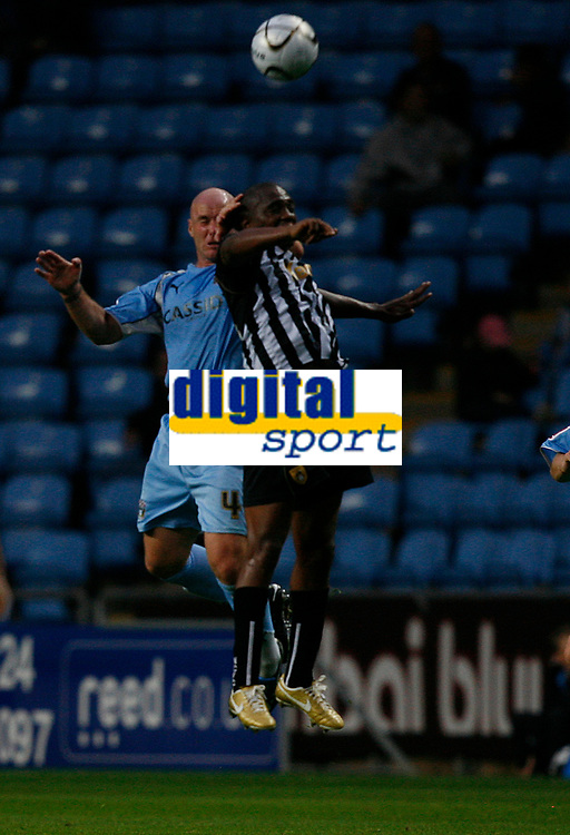Photo: Steve Bond.<br />Coventry City v Notts County. The Carling Cup. 14/08/2007. Hector sam (front) in an aerial challange with Robert Page (back)