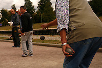 Bicycling along the Canal d'Ourcq, near Paris -men playing petanque (boules)  at Pavillons sur Bois...September 17, 2012..Photograph by Owen Franken for the NY Times