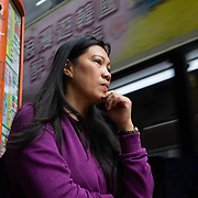 Vanessa Mae Rodel, 42,  waits for a bus to take her to Castle Peak Immigration Centre, in Hong Kong on March 18, 2019. / Photo: Maria de la Guardia