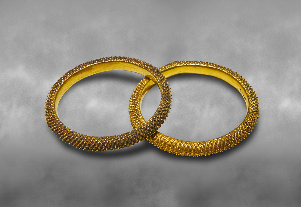 Bronze Age Hattian gold bracelet  from a possible Bronze Age Royal grave (2500 BC to 2250 BC) - Alacahoyuk - Museum of Anatolian Civilisations, Ankara, Turkey .<br /> <br /> If you prefer to buy from our ALAMY PHOTO LIBRARY  Collection visit : https://www.alamy.com/portfolio/paul-williams-funkystock/royal-tombs-alaca-hoyuk-bronze-age.html (TIP refine search by adding background colour in the LOWER search box)<br /> <br /> Visit our ANCIENT WORLD PHOTO COLLECTIONS for more photos to download or buy as wall art prints https://funkystock.photoshelter.com/gallery-collection/Ancient-World-Art-Antiquities-Historic-Sites-Pictures-Images-of/C00006u26yqSkDOM