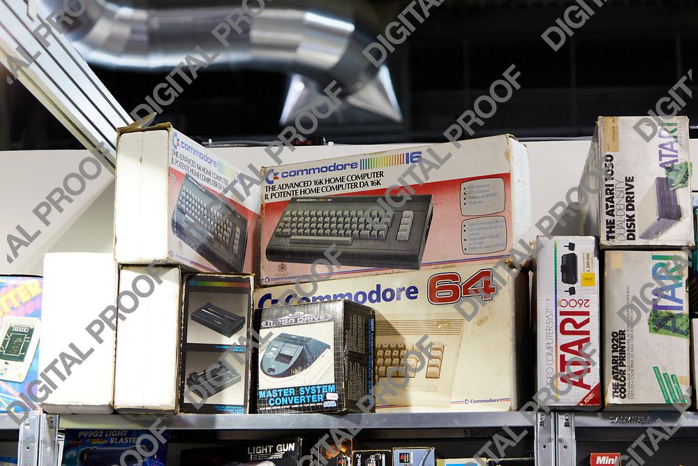 Milan, Italy - March 8 2019 Cartoomics Comic Con Vintage computer model commodore 64 being sold
