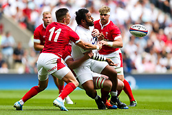 Billy Vunipola of England is tackled by Adam Beard and Josh Adams of Wales - Rogan/JMP - 11/08/2019 - RUGBY UNION - Twickenham Stadium - London, England - England v Wales - Quilter Series.