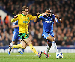 Chelsea`s Didier Drogba  battles with Zalina's Roman Gergel  Chelsea vs MSK Zilina  for the  Uefa Champions Premier League, Group H,  at Stamford Bridge stadium in London on 23/11/2010. Picture By Rob Noyes  ©IPS   Photo Agency:21 Delisle Road  London SE28 0JD - Personal mobile: 07966 515 681