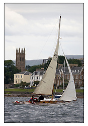 Mignon 1898 Sloop off Rothesay...Overcast day for sailors heading south from Rhu to Rothesay...* The Fife Yachts are one of the world's most prestigious group of Classic .yachts and this will be the third private regatta following the success of the 98, .and 03 events.  .A pilgrimage to their birthplace of these historic yachts, the 'Stradivarius' of .sail, from Scotland's pre-eminent yacht designer and builder, William Fife III, .on the Clyde 20th -27th June.   . ..More information is available on the website: www.fiferegatta.com . .Press office contact: 01475 689100         Lynda Melvin or Paul Jeffes