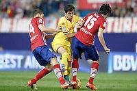 Atletico de Madrid's Gabi Fernandez (l) and Stefan Savic (r) and Sporting de Gijon's Carlos Castro during La Liga match. November 8,2015. (ALTERPHOTOS/Acero)