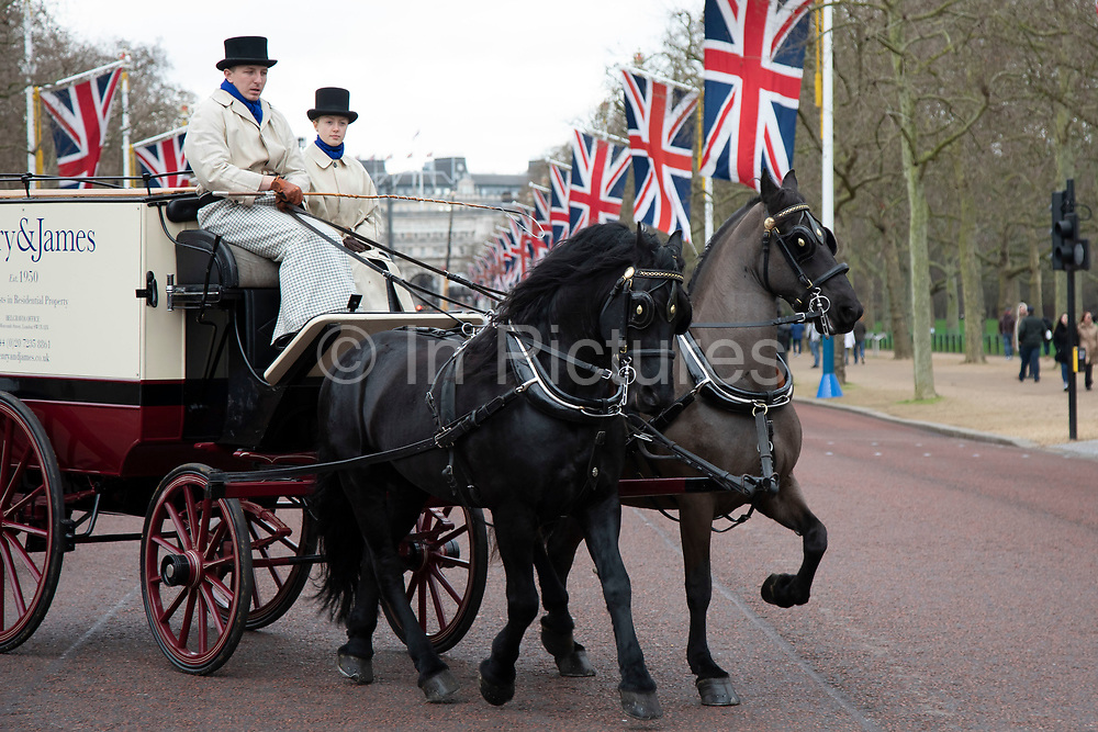 Scenes along The Mall with a passing horse drawn carriage which is lined by Union Jack flags in Westminster on Brexit Day as the UK prepares to leave the European Union on 31st January 2020 in London, England, United Kingdom. At 11pm on Friday 31st January 2020, The UK and N. Ireland will officially leave the EU and go into a state of negotiations as to the future arrangement and trade agreement, while adhering to EU rules until the end of 2020.