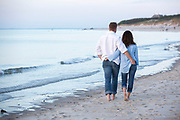 A couple are photographed at a Cape Cod beach.