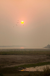 Sunset over lake by foggy weather, Laos