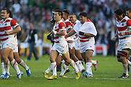 Japan players celebrate after the final whistle during the Rugby World Cup Pool B match between South Africa and Japan at the Community Stadium, Brighton and Hove, England on 19 September 2015. Photo by Phil Duncan.