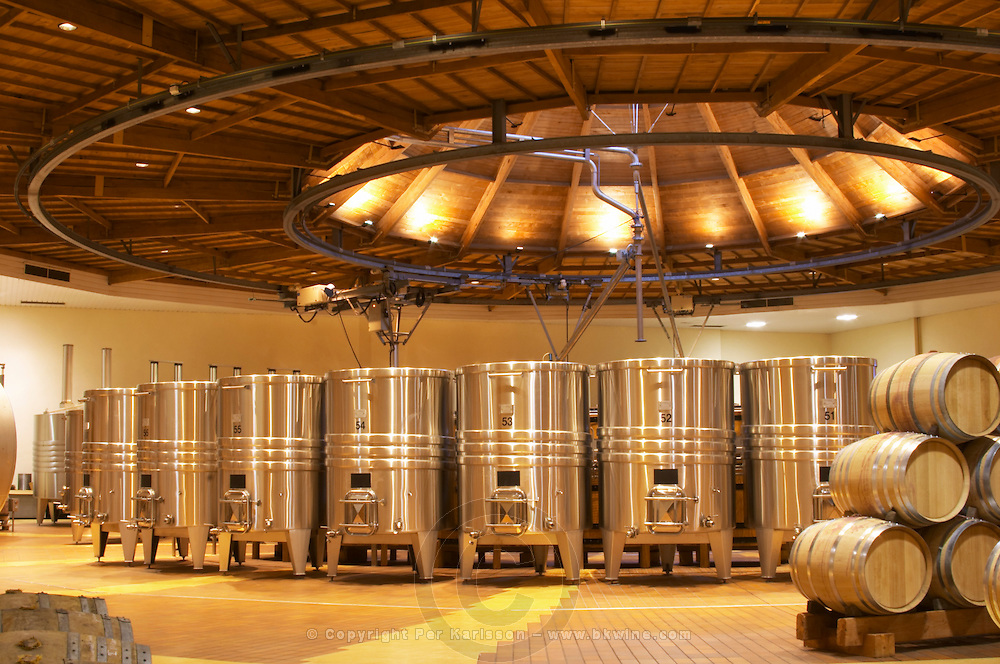 The winery with wooden and stainless steel fermentation vats. It is built in a circular design and made from chestnut wood to fight insects and oak barrels, Maison Louis Jadot, Beaune Côte Cote d Or Bourgogne Burgundy Burgundian France French Europe European